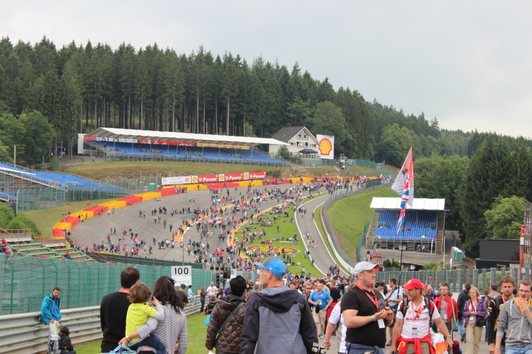 Fans swarm onto Eau Rouge after the race