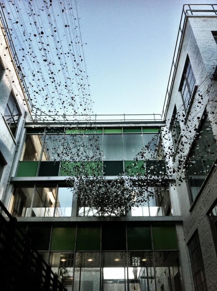 The juxtaposition of modern art against industrial buildings - Clarks Factory Street