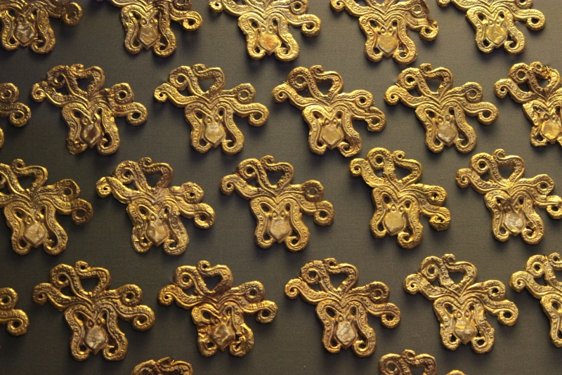 Gold octopus shaped cut outs which would have been sewn onto luxurious attire. They date from 1700 BC from Grave Circle A of the Mycenaean Acropolis.