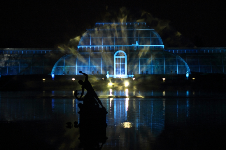 The Palm House Pond illuminated by brightly coloured laser beams set to music.