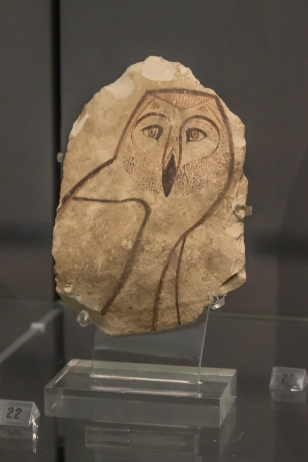 Egyptian limestone ostracon, from New Kingdom, 1550-1070 BC. The owl spells an 'm' sound. Fitzwilliam Museum, Cambridge