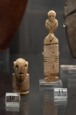 10: Egyptian limestone figure of a man, 3500-3000 BC. 11: Egyptian ivory figure of a woman, 3500-3000 BC, from Matmar, grave 2682. Fitzwilliam Museum, Cambridge