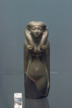 Egyptian greywacke statue of a woman, Dynasty 13, 1794-1648 BC. An idealised figure of a woman wearing a hathor wig, which was common at this time.