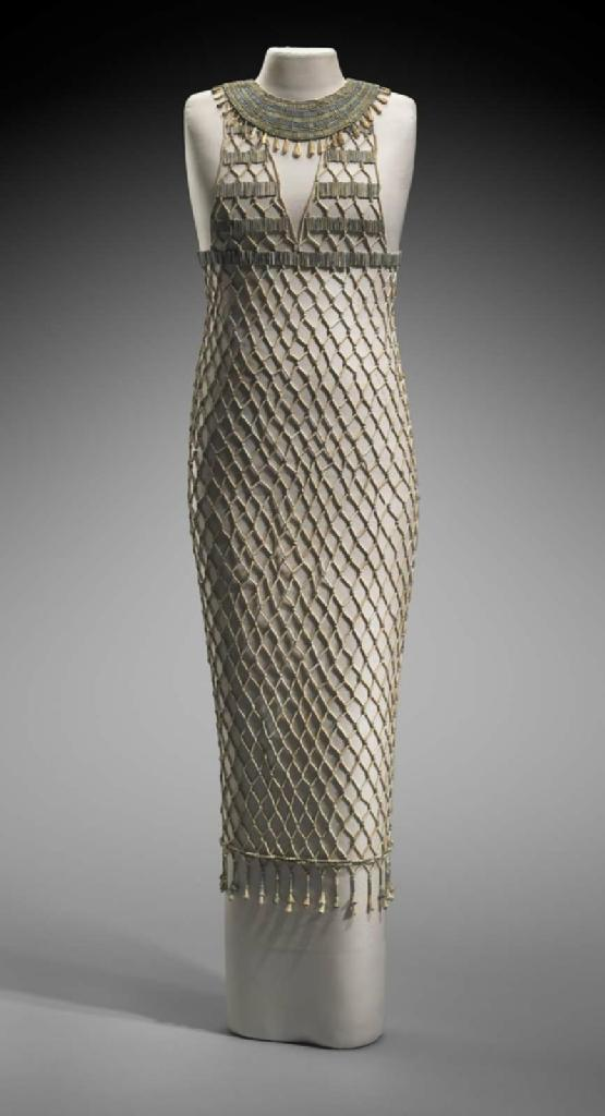 Bead-net dress found in an Old Kingdom tomb in Giza, showing the lozenge-shaped patterns created by the beads.